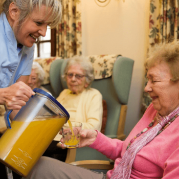 Fill Line Jug with Orange Juice in Care Home